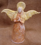 Angel with spirals. hand thrown and moulded. 14cm across, 17cm high.  £20. postage to UK £2.85