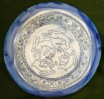 Blue Rabbits design plate. 25cm across, by 2.5cm high. £46, postage to Uk £2.85 ( BP12)