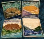 Lochcarron relief Tile/ Coasters. 9.5cm across. £6 each. all different. £2.85 postage ( same postage for a few tiles )