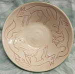 wolf bowl. 13cm across, by 3cm high. £14. postage to Uk £2.85