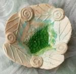 small pale turquoise and green glass leaf dish. 2cm high by 7cm across. £7.50.  £2.85 postage to UK (BP37)