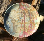 hand made asymmetric stoneware plate. multicoloured. 28cm across x 2 high. £30 (PL5) postage to uk £2.85