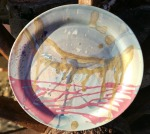 wheel thrown stoneware plate. multicoloured. 24cm across x 2 high. £28 (PL3) postage to uk £2.85